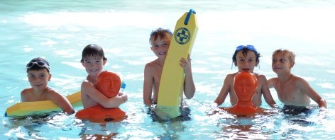 Five boys in a pool with lifesaving equipment