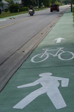 Cycling symbol on green path alongside road