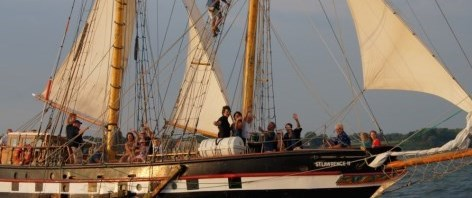 Tall sailing ship on Lake Erie with people waving