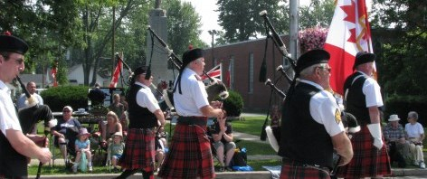 Bagpipe players march in the Fun Fest Parade