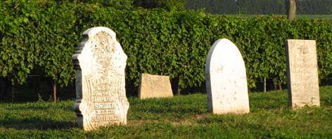 Three old tombstones in a row
