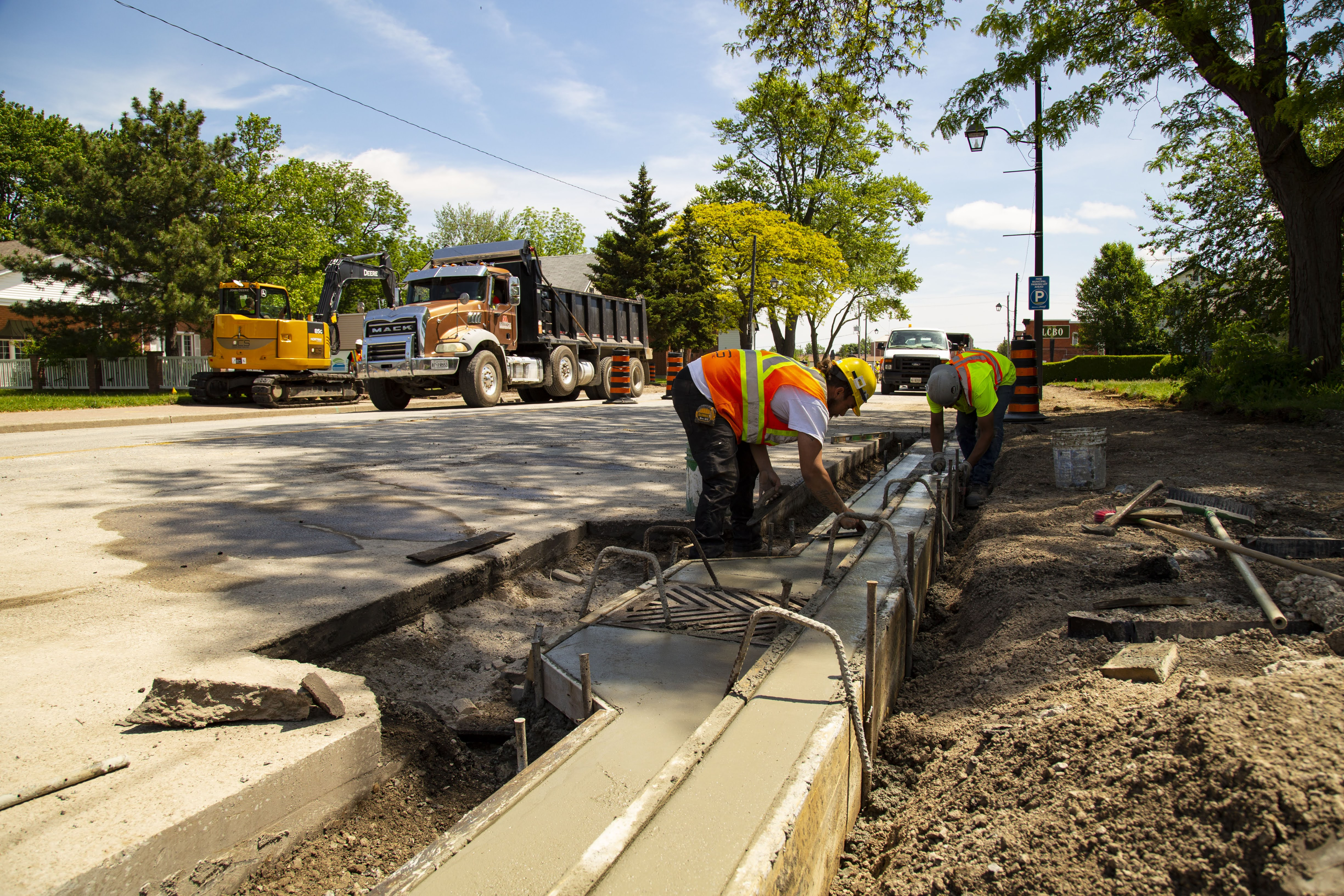 Construction worker working on a concrete curb as part of the Harrow Streetscape project.