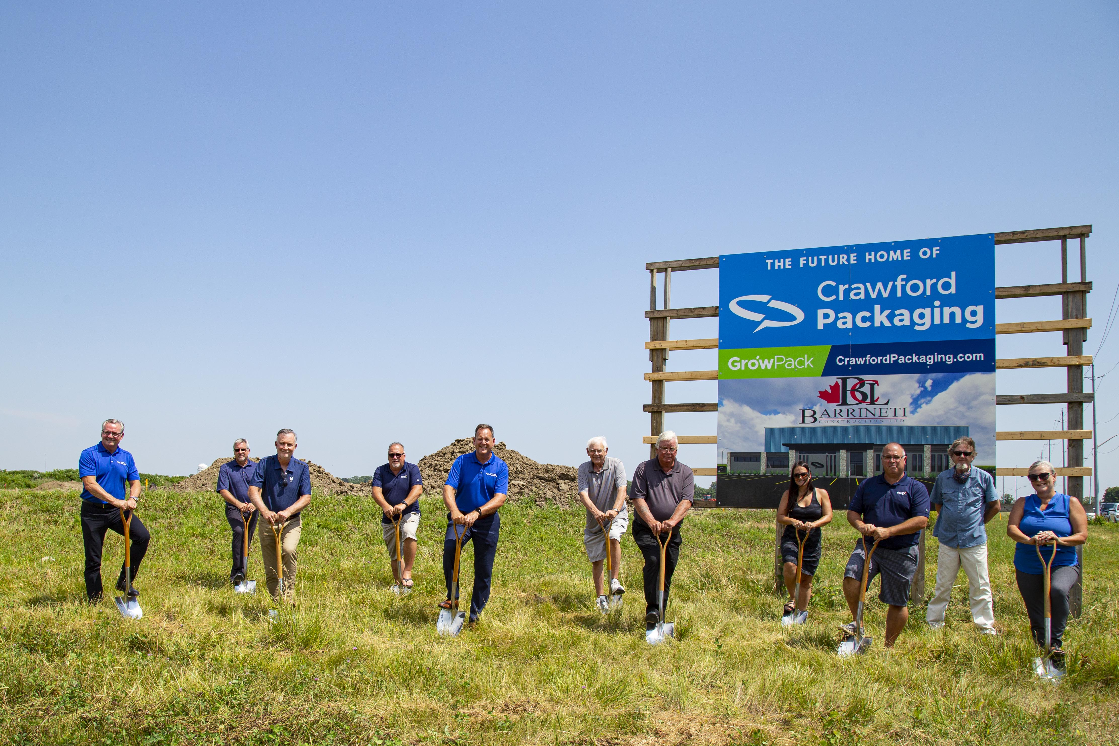 Crawford Representatives and Council Members holding shovels for ground breaking.