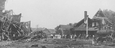 People walking through the debris after a train explosion