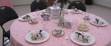 Table setting for baby shower with china teacups