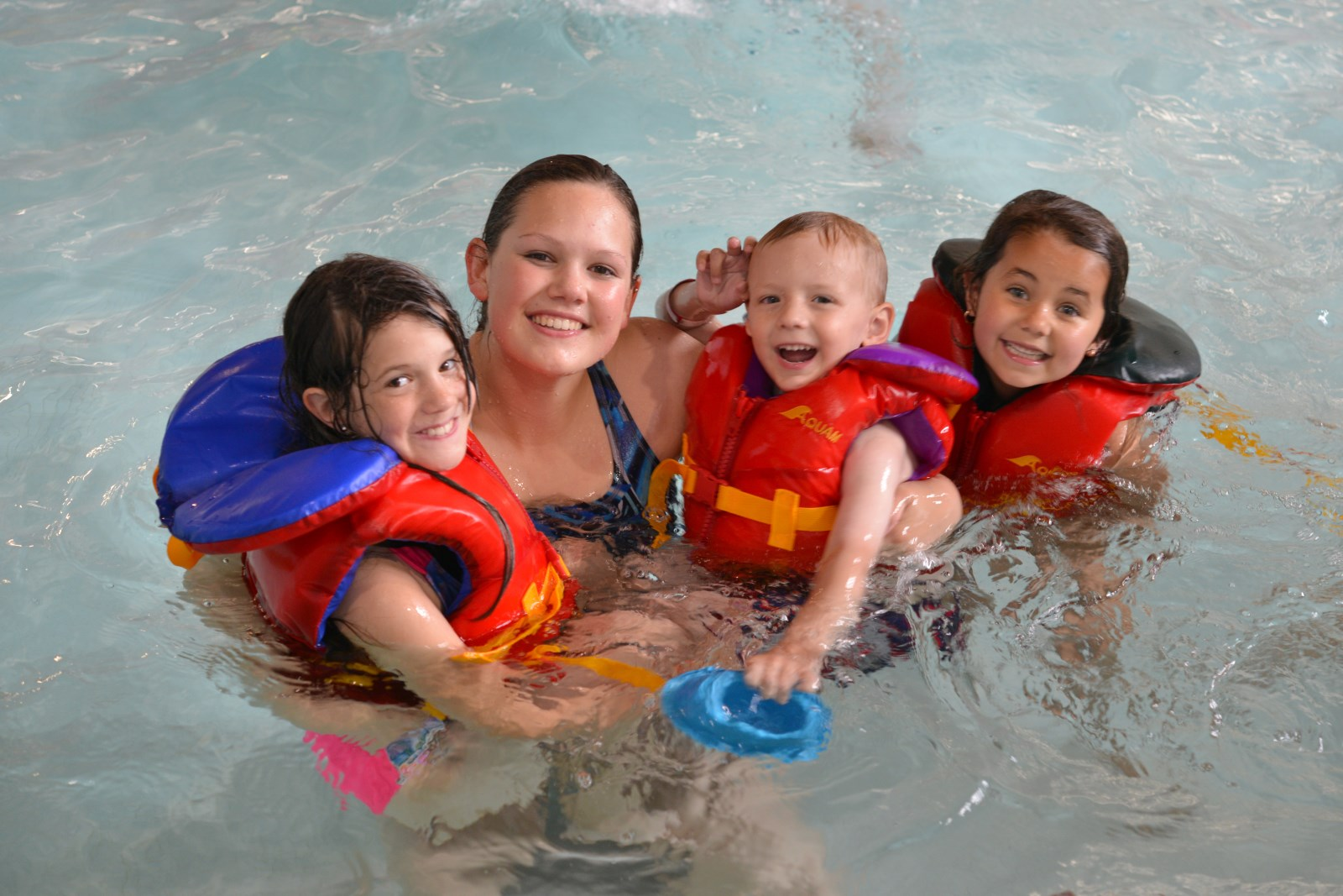 Image of staff and kids in the pool at the Essex Recreation Complex